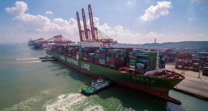 In this Aug. 6, 2019, photo, tugboats manuever a container ship at a port in Qingdao in eastern China's Shandong province. Chinese exports to the United States declined 6.5% in July to $38.8 billion. (Chinatopix via AP)