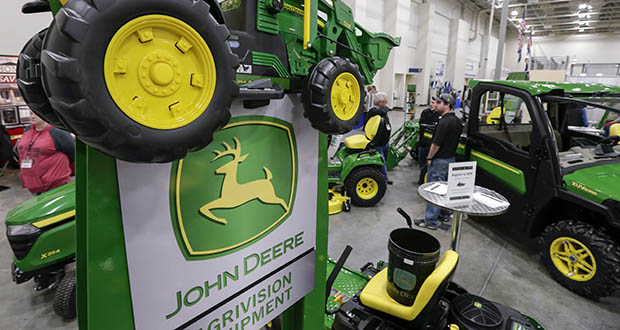 Deere & Co. reported strong activity in the construction industry in its latest earnings report. Sales of related equipment rose by a percent and profit rose 35%. In this Feb. 23, 2018, photo, John Deere products are on display at a home and garden trade show in Council Bluffs, Iowa. (AP file photo)
