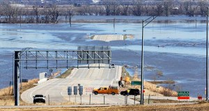 In this March 16 photo, Nebraska Department of Roads crews block the flooded Highway 34 that connects Platteview, Nebraska, to I-29 in Iowa. (AP file photo: Nati Harnik)