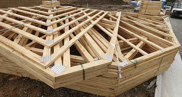 A big 50% jump in new home sales in the Northeast in July was offset by declines in the West, Midwest and South. This June 13 photo shows stacks of building materials near a new home under construction in Mechanicsville, Virginia. (AP file photo)