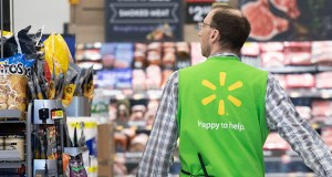 Sales at stores opened at least a year rose 2.8%, its 20th consecutive quarter in the right direction as Walmart continues to expand its grocery delivery services. In this April 24 photo, a Walmart associate walks through a Walmart Neighborhood Market in Levittown, New York. (AP file photo)
