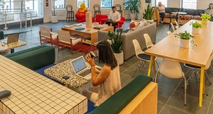 For many firms in the sector, WeWork's IPO, planned for next month with a target of $3.5 billion, proves co-working is here to stay. This May 22 photo shows the cafeteria at the WeWork co-working space at 85 Broad St. in the Manhattan borough of New York. (Bloomberg file photo)