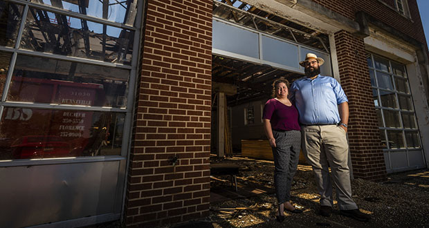 Megan and Bill Morrow pose Aug. 16 outside the former Decatur Fire and Rescue Station No. 1 off Gordon Drive in Decatur, Ala., which they plan to transform into a home. (Dan Busey: The Decatur Daily via AP)