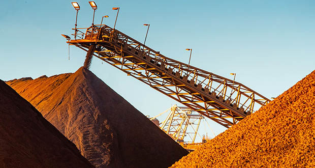 Iron ore's fortunes -- and those of the top miners in Australia and Brazil -- largely turn on the strength and trajectory of demand in China, which buys about 70% of seaborne cargoes. This March 18 photo shows a conveyor delivering iron ore to a stockpile at the Port of Port Hedland in Port Hedland, Australia. (Bloomberg file photo)
