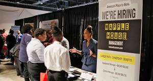 The unemployment rate remained 3.7% for a third straight month, the Labor Department said Friday, near the lowest level in five decades. In this Aug. 14 photo, a Waffle House representative speaks to potential applicants during a job and resource fair in Atlanta. (File photo: Bob Andres/Atlanta Journal-Constitution via AP)