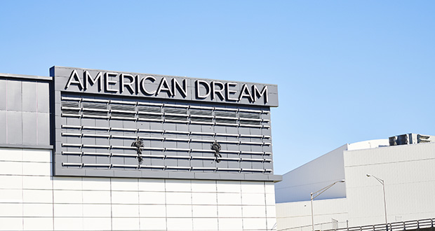 Signage stands outside the American Dream complex in East Rutherford, New Jersey, on Aug. 29. As the Oct. 25 opening of the mall approaches, traffic skepticism has taken root even among some who had cheered the state incentives to help complete the project. (Bloomberg photo: Gabby Jones)