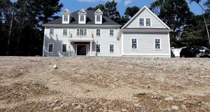This Sept. 3 photo shows a newly constructed home in Westwood, Massachusetts. The Commerce Department said Wednesday that new home sales slipped in the Northeast in August. (AP file photo)