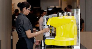 The Labor Department said Tuesday that it is raising the salary level that companies will have to pay to exempt workers from overtime to $35,308 a year, up from $23,660. In this Aug. 8 photo an employee works at a McDonald's restaurant in Chicago. (AP file photo)