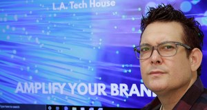 """Gabe Uribe, co-owner of L.A. Tech House, a public relations firm that focuses on tech companies, poses Sept. 17 in his office in Beverly Hills, California. When he began advertising online, he went with the common wisdom that the more spent on Google ads, the better the results. But he learned he could cut his budget and be fine. """"If you put some strategy into it, you have a good chance of going up against the big guys,"""" Uribe says. """"We own our little corner with tech PR."""" (AP Photo: Damian Dovarganes)"""