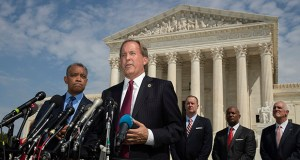 Texas Attorney General Ken Paxton, center, with District of Columbia Attorney General Karl Racine, left, and a bipartisan group of state attorneys general speaks to reporters in front of the U.S. Supreme Court in Washington on Monday about an antitrust investigation of big tech companies. (AP Photo: Manuel Balce Ceneta)