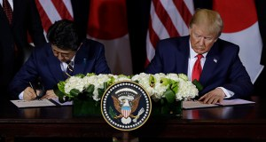 President Donald Trump and Japanese Prime Minister Shinzo Abe sign the first stage of a trade agreement Wednesday at the InterContinental Barclay New York hotel during the United Nations General Assembly in New York. (AP Photo: Evan Vucci)