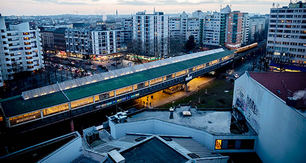 This January 2019 photo shows the Kottbusser Tor U-Bahn station at dusk in Berlin. Berlin's government has announced a plan to combat rising housing prices by freezing rents for the next five years. (Bloomberg file photo)