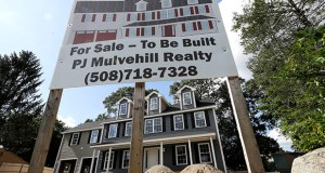 In this Sept. 3, 2019 photo a for sale sign, top, rests in front of a newly constructed home, in Norwood, Mass. On Thursday, Oct. 17, the Commerce Department reports on U.S. home construction in September. (AP Photo/Steven Senne)