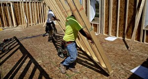 The National Association of Home Builders/Wells Fargo Housing Market Index rose for the fourth straight month in October. In this May 15 photo, workers lift a wall frame in a home under construction at a K. Hovnanian Homes development in Plano, Illinois. (Bloomberg file photo)