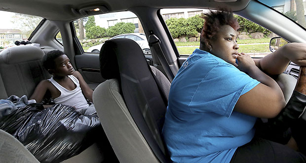 Lonisha Jordan and her son, Jamury, 10, pictured Oct. 9 in their family's car in Madison, Wisconsin. The family lives from its car, motels or other places and is on a waiting list for CDA housing. (Photo: John Hart/Wisconsin State Journal via AP)