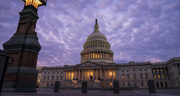 The Capitol in Washington is seen at dawn on Oct. 3. The U.S. deficit surpassed $1 trillion in the first 11 months of the fiscal year, which just ended last month. And the Congressional Budget Office forecasts the shortfall this fiscal year will exceed $1 trillion. (AP Photo: J. Scott Applewhite)