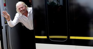 Richard Branson, of Virgin Group, waves as he arrives April 4 on a Brightline train in West Palm Beach, Florida. Branson, who has gone from owning the Virgin record label to planning space flights, has been an inspiration for Elizabeth Babinski in her wedding business. (AP file photo)
