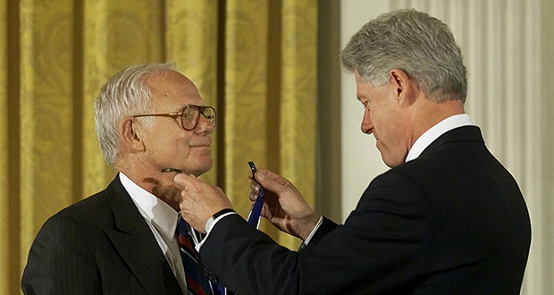 President Clinton, right, awards the Presidential Medal of Freedom to Jim Burke, CEO of Johnson and Johnson, during ceremonies Aug. 9, 2000, in the East Room of the White House in Washington. Burke's response to Tylenol capsule poisonings is widely considered a standard of responsibility other businesses should strive for. (AP file photo)