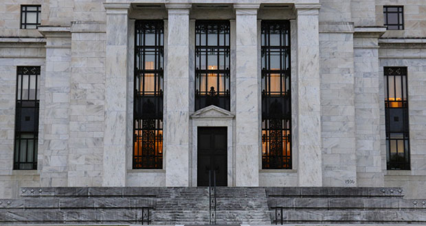 This July 31 photo shows the Federal Reserve Building in Washington. The Federal Reserve says corporate debt remains at historically high levels but overall the U.S. financial system is resilient, a view in sharp contrast to the problems that led to the 2008 financial crisis.