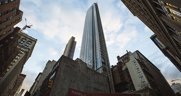 The exterior of Madison House, an 800-foot residential high-rise under construction in the NoMad neighborhood of New York, is shown on October 28th. (Bloomberg photo: Angus Mordant)