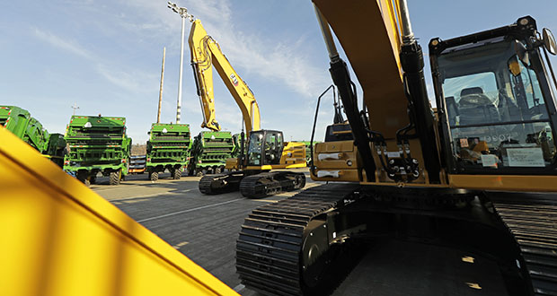 John Deere Farm and Cat construction equipment made by Deere & Company and Caterpillar are shown Monday as they are readied for export to Asia at the Port of Tacoma in Tacoma, Washington. (AP Photo: Ted S. Warren)