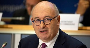 European Commissioner designate for Trade Phil Hogan makes his opening statement during his hearing at the European Parliament in Brussels, Monday, Sept. 30, 2019. (AP Photo/Virginia Mayo)