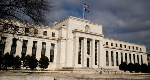 After lowering interest rates three times, Fed policymakers left them unchanged on Dec. 11. The central bank has also made or proposed various changes in financial oversight. This photo shows the Federal Reserve building in Washington, D.C. (Bloomberg file photo)