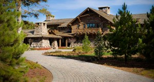 This may look like a vacation resort, but Crow Wing Lodge is a nine-bedroom, 11-bath, 17,359-square-foot, single-family home at 13095 Pelican Circle N.  in Breezy Point. (Submitted photo: Lakes Sotheby's International Realty)