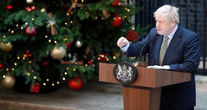 Britain's Prime Minister Boris Johnson addresses the media Friday outside 10 Downing Street in London. Johnson's Conservative Party has won a thumping majority of seats in Britain's Parliament — a decisive outcome to a Brexit-dominated election that should allow Johnson to fulfill his plan to take the U.K. out of the European Union next month. (AP Photo: Frank Augstein)