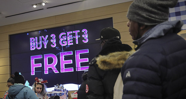 Shoppers stand in line to make Black Friday discount purchases at Bath and Bodyworks, Friday Nov. 29, 2019, in Brooklyn, N.Y. (AP Photo/Bebeto Matthews)