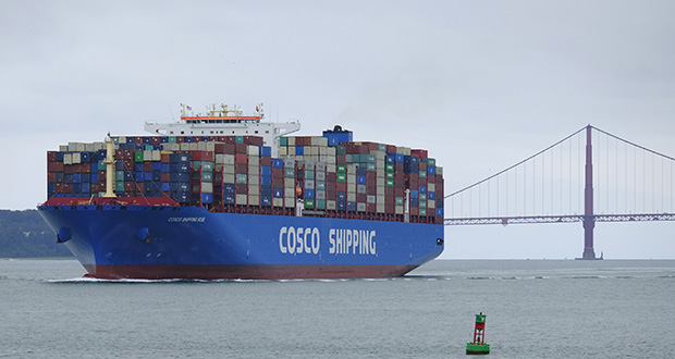 In this May 14, 2019 file photo, a Cosco Shipping container ship passes the Golden Gate Bridge in San Francisco bound for the Port of Oakland. (AP Photo/Eric Risberg, File)