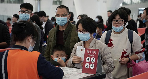 Passengers wear masks Wednesday to prevent an outbreak of a new coronavirus in the high speed train station, in Hong Kong. Health authorities across Asia have been stepping up surveillance and other precautions to prevent a repeat of the disruptions and deaths during the 2003 SARS crisis, which caused $40 billion-$50 billion in losses from reduced travel and spending. (AP Photo: Kin Cheung)