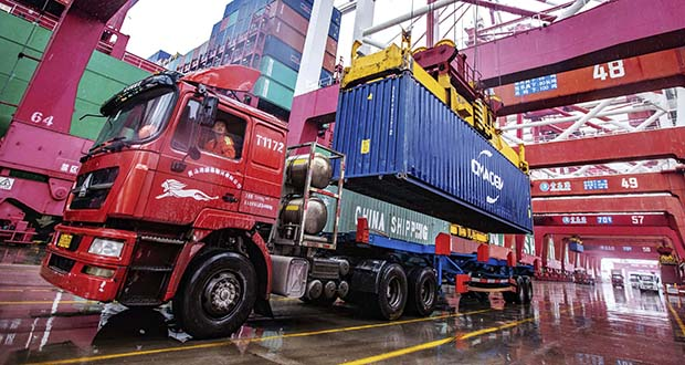 A worker waits to transport containers Tuesday at the container port in Qingdao in eastern China's Shandong province on Tuesday. China's exports rose 0.5% in 2019 despite a tariff war with Washington after growth rebounded in December on stronger demand from other markets. (Photo: Chinatopix Via AP)