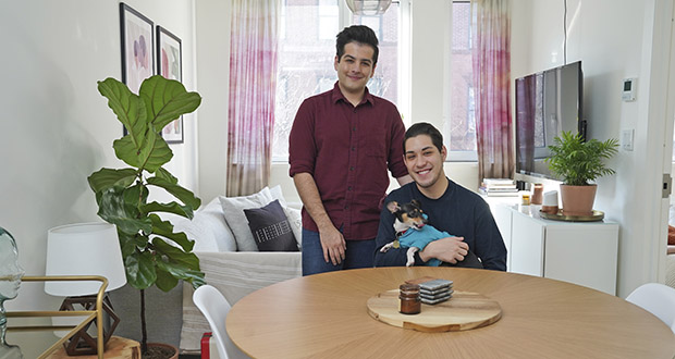 In this Nov. 25 photo, Zachariah Mohammed, left, Pete Mancilla, and their dog Remy pose for a picture in their apartment in New York. Most of the furniture in their apartment, including the couch, the table and chairs, the side table and the bar cart, are rented. Furniture-rental startups and other companies are aiming to rent furniture to millennials who don't want to commit to big purchases or move heavy furniture and are willing to pay for the convenience. (AP Photo/Seth Wenig)
