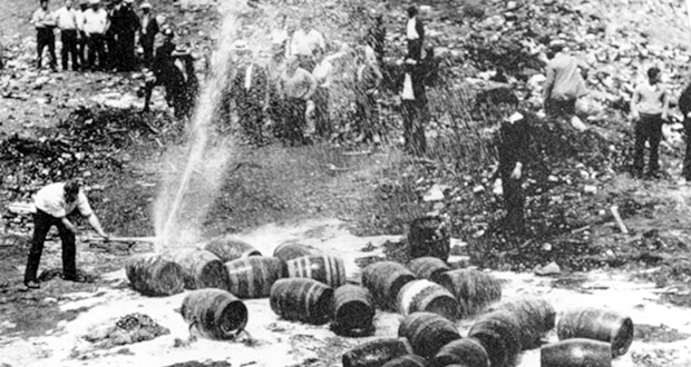 In this June 18, 1931, photo, beer barrels are destroyed by prohibition agents at a dump in New York City. The federal government, as well as state and local authorities, spent huge sums on enforcement yet never allocated sufficient resources to do the job effectively. Bootleggers awash in cash bribed judges, politicians and law enforcement officers to let their operations continue. (AP file photo)
