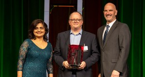 Flywheel won a 2019 Tekne Award in the cloud computing category from the Minnesota High Tech Association. From left, Rakhi Purohit, director of technology at Thomson Reuters and MHTA board member; Flywheel CEO Travis Richardson; and Jeff Tollefson, president and CEO, MHTA. (Photo courtesy of the Minnesota High Tech Association)