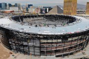 This Dec. 18, 2019, photo shows an aerial view of Allegiant Stadium the new NFL football stadium under construction in Las Vegas. Installation of a translucent roof for the $2 billion football stadium being built in Las Vegas for the NFL's Raiders is months behind schedule but officials say it should be done by May. (Photo: Michael Quine/Las Vegas Review-Journal via AP)