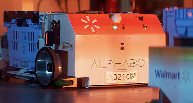 Alphabot's robotic carts quickly retrieve items and deliver them to employees at a picking station, who then pack and deliver the order to customers' cars in the parking lot. (Submitted photo: Walmart)