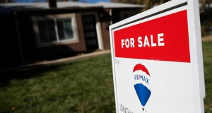 In this Oct. 22, 2019, file photo, a sign stands outside a home for sale in southeast Denver. (AP Photo/David Zalubowski, File)