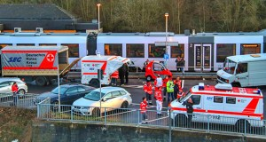 Emergency cars and police are standing at the station in Idar-Oberstein, Germany, Wednesday, Feb. 26, 2020 after a regional train with about 70 passengers was stoped on suspicion of coronavirus. (Sebastian Schmitt/dpa via AP)