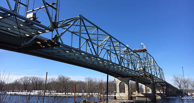 Thursday morning, crews began the methodical process of lowering the massive center span of the old Red Wing bridge over the Mississippi River onto two river barges. (Submitted photo: MnDOT)