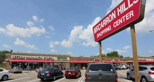 The St. Paul Area Chamber of Commerce's WorkStream division has a contract to develop plans for the Rice-Larpenteur area at the intersection of St. Paul, Roseville and Maplewood. That area features the McCarron Hills Shopping Center, shown in this July 2018 photo. (File photo: Bill Klotz)