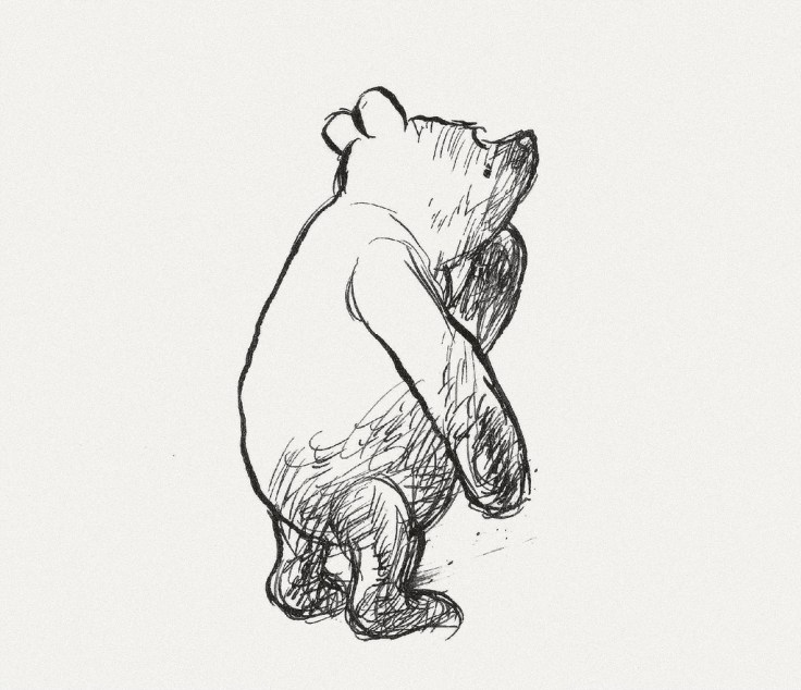 A black and white sketch of Pooh bear