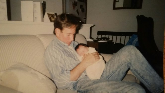 Dad holding me as a baby