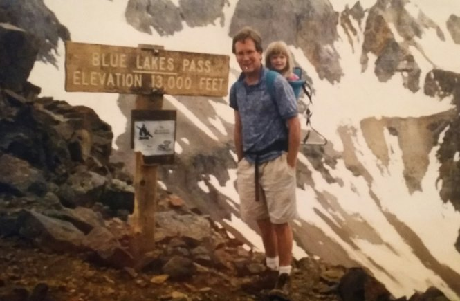 My dad carrying me up a mountain