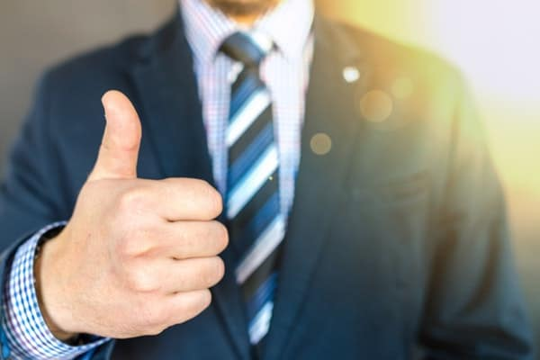 Thumbs up by young professional representing growth opportunities at a large organization