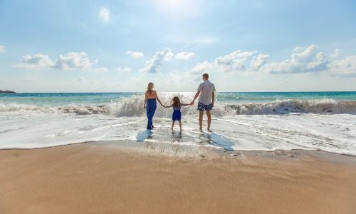 Family on the bach living a debt free life
