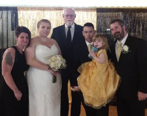 The Flower Girl (their daughter) needed to be held by daddy during the ceremony!