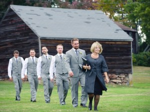 Leading the groom and groomsmen in at Oliver and Erin