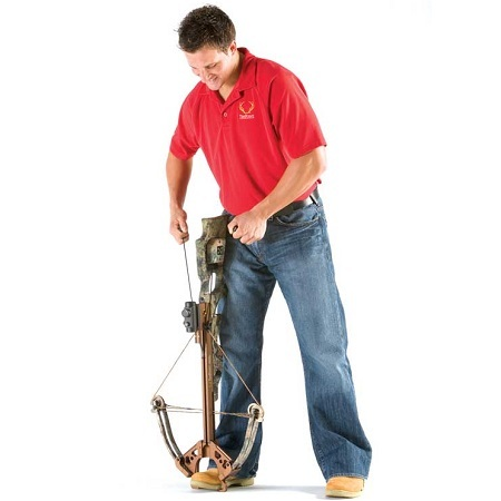 Man Cocking A Crossbow